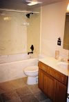 Basement bath dark oak beaded cabinets onyx countertop