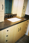 Bathrooms (2) Bamboo and black console cabinets, Granite countertops